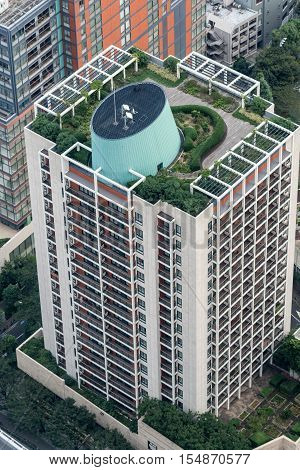 Tokyo Japan - September 26 2016: Aerial view since shot off Observatory tower. Apartment tower with roof garden in Roppongi neighborhood of Tokyo. Parts of other highrise buildings in photo.
