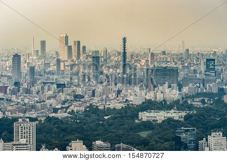 Tokyo Japan - September 26 2016: Aerial view since shot off Observatory tower. The Ministry of Defense is located behind the Government Office in its park. The tall antenna of Defense stands out among many highrise buildings.