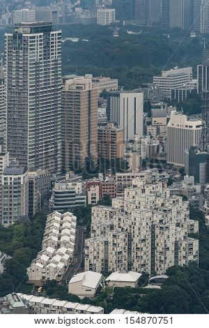 Tokyo Japan - September 26 2016: Aerial view since shot off Observatory tower. Relatively low black-and-white apartment complex in Tokyo resembles a stack of shipping containers. Park and highrise buildings in photo.