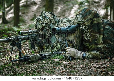 United states army rangers sniper pair in the forest