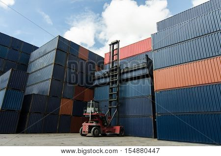 container box loading at yard.Toplift handling container box in shipyard at dusk for Logistic Import Export background