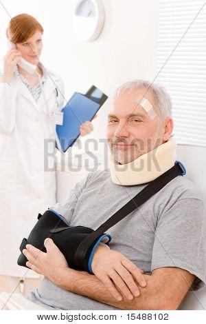 Senior Patient Broken Arm In Doctor Office