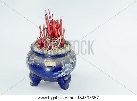 Incense burner and fire on white background