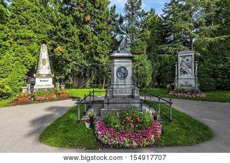 Graves Of Composers Famous At The Zentralfriedhof Cemetery In Vienna.