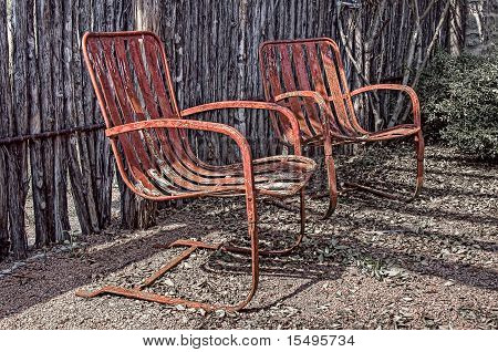 2 old rusty chairs