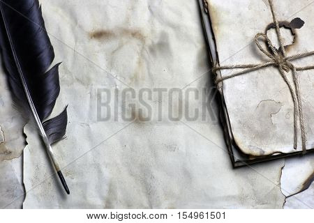 old paper letter and black feather writing concept