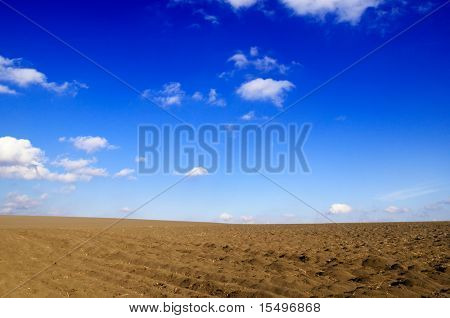 ploughed field and the blue sky