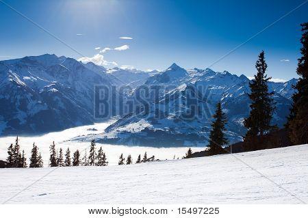 View over kaprun ski resort next to kitzsteinhorn peak in austrian alps from Schmitten peck