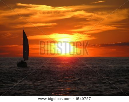 Sailboat And Sunset