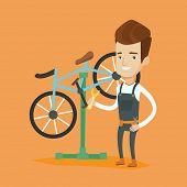 Постер, плакат: Caucasian man working in bike workshop Technician fixing bicycle in repair shop Bicycle mechanic r