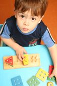 image of child development  - The child is keen collecting logic game - JPG