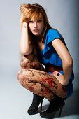 young blond fashion model with unusual hosiery poster