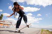 foto of skate board  - cool skateboard woman at a public graffiti park - JPG