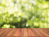 Wood Table With Blur Tree Background. Abstract Blur Background Wood Table For Display Your Product. poster
