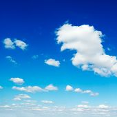 fluffy clouds in the blue sky poster