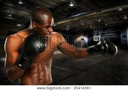 Young African American Boxer working out at a gym