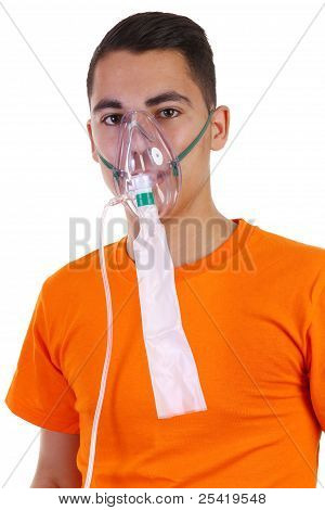 A Young Guy Wearing An Oxygen Mask