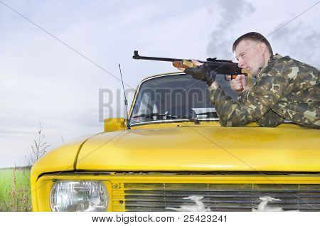 Sniper In Camouflage On Car