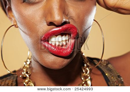 African woman bares her teeth
