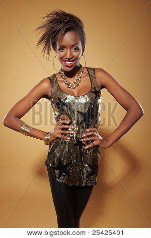 Slim african woman with arms akimbo