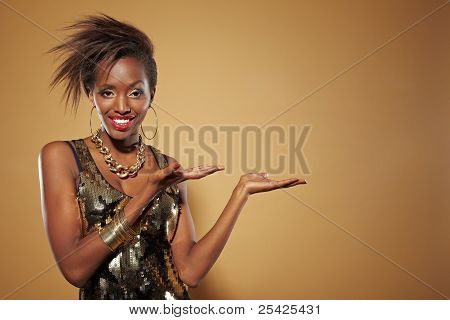 Happy african woman presenting