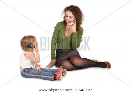 Mother And Daughter Talk On The Cell Phones