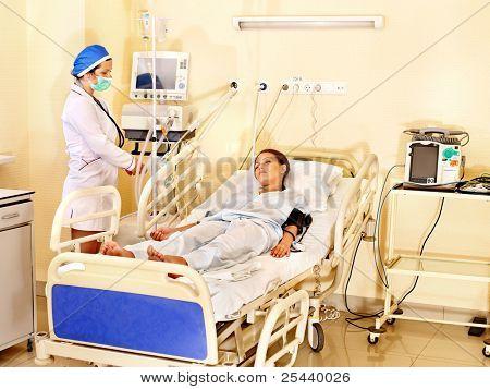 Doctor treats female patient with stethoscope. Medicine. Medicine.