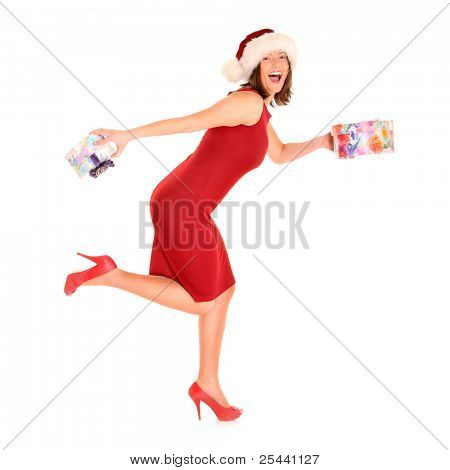 A picture of a pretty woman in Santa's costume running with presents over white background