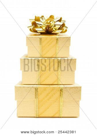 Stack of gold Christmas gifts