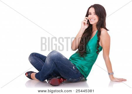 Girl Sitting And Talking On Phone