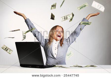 mujer de negocios gota dólares en el aire