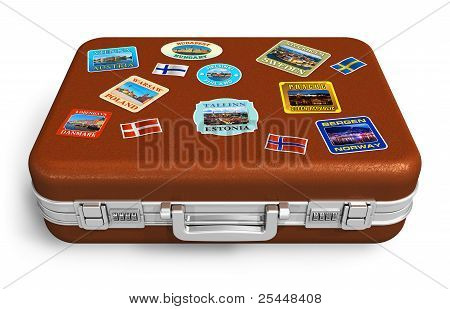 Leather travel suitcase with labels