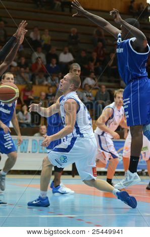 KAPOSVAR, HUNGARY - OCTOBER 15: Nik Raivio (C) in action at a Hugarian National Championship basketball game Kaposvar (white) vs. Jaszbereny (blue) on October 15, 2011 in Kaposvar, Hungary.