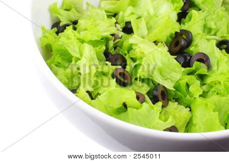 Part Of White Dish With A Lettuce And Olives