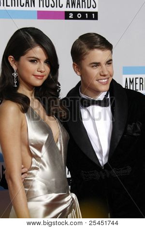 LOS ANGELES - NOV 20:  Selena Gomez, Justin Bieber arrives at the 2011 American Music Awards at Nokia Theater on November 20, 2011 in Los Angeles, CA