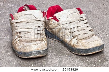 Two dirt shoes on floor