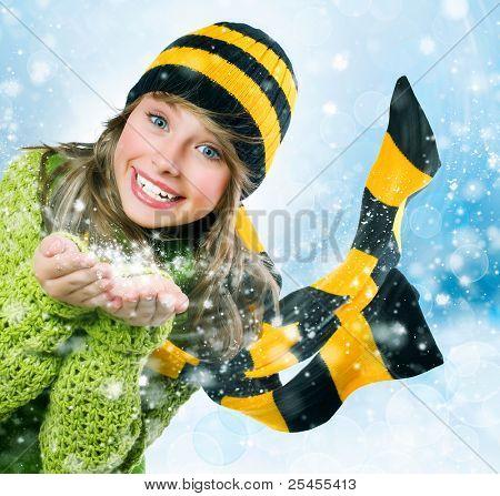Christmas Girl.Winter Teenage girl Blowing Snow