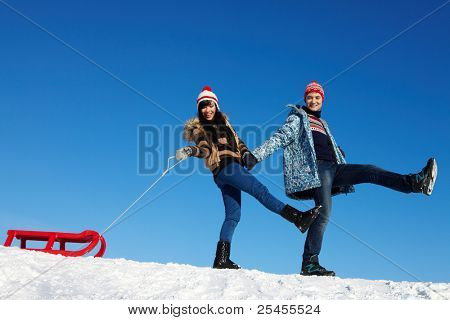 Portrait of happy couple in warm clothes spending time outdoor in winter