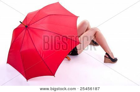 sexy Woman standing under red umbrella