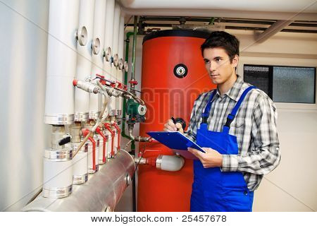 heating engineer in the boiler room