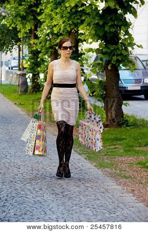 woman with shopping bags when shopping