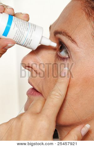 woman with eye drops and allergy.