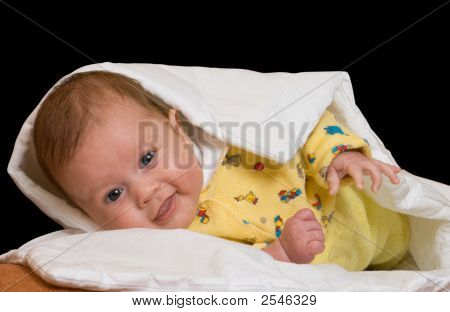 Baby On Blanket Over Black