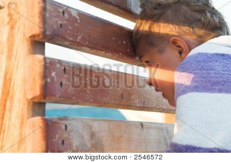 The Boy Spies On A Beach