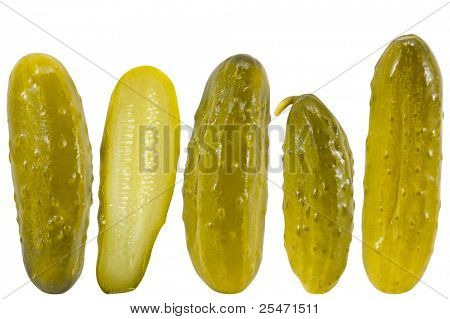 Pickled dill cucumbers against a white background