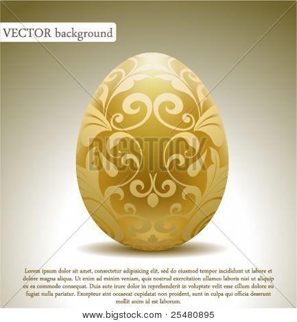 Golden egg with floral decoration.