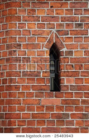 Narrow Window At A Brick Wall in Tangermuende in Germany