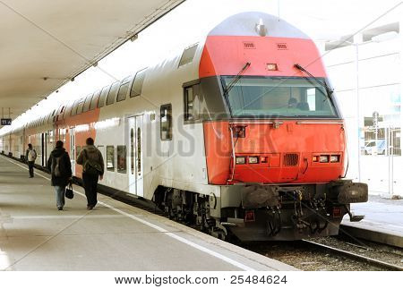 Modern doubledeck train on a platform