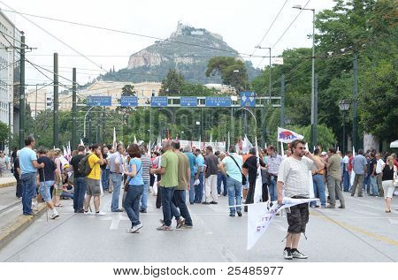 ATHENS, GREECE - JUNE 15: General strike against the Greek parliament discussed new $40.36 billion austerity program of tax hikes, spending cuts and sell-offs of state property on June 15, 2011 in Athens, Greece