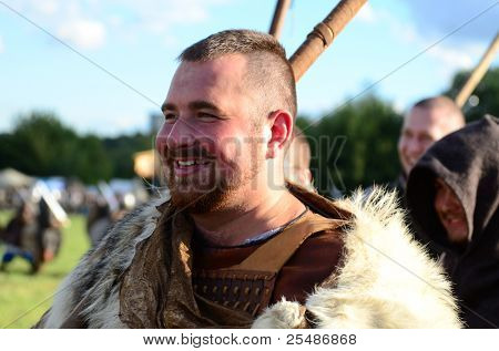 """MOSCOW - SEPTEMBER 4: The laughing warrior on The international festival of fights """"Times and epoch"""". With over 130000 spectators on September 4, 2011 in Moscow, Russia."""